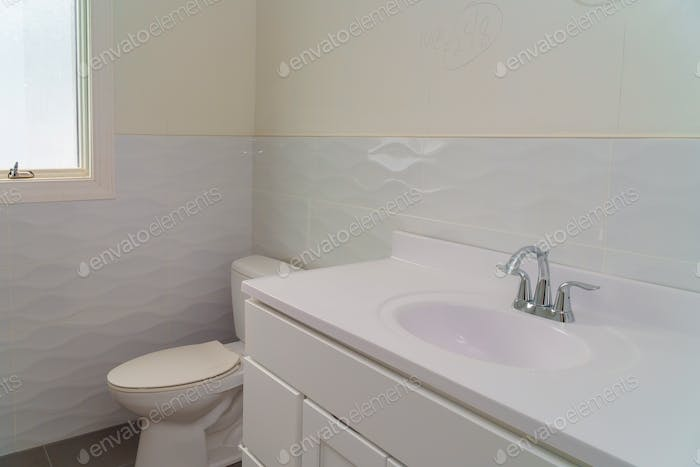 Bright space a white bathroom with a washbasin, a bidet and a bowl