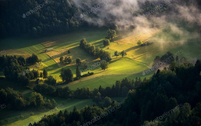 Village and countryside on a misty morning