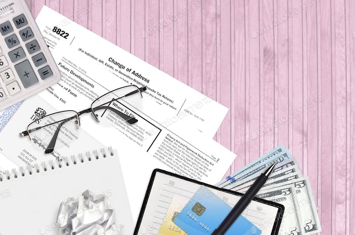 IRS form 8822 Change of Address lies on flat lay office table and ready to fill