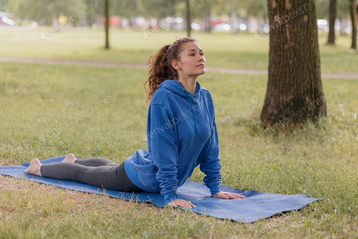 woman doing leg bends or muscle stretching