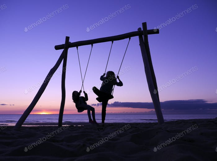 A swing, sunset and a beach. Perfect combination