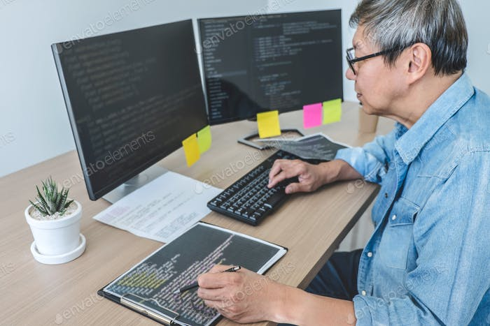 Senior Professional programmer working at developing programming and website working in a software