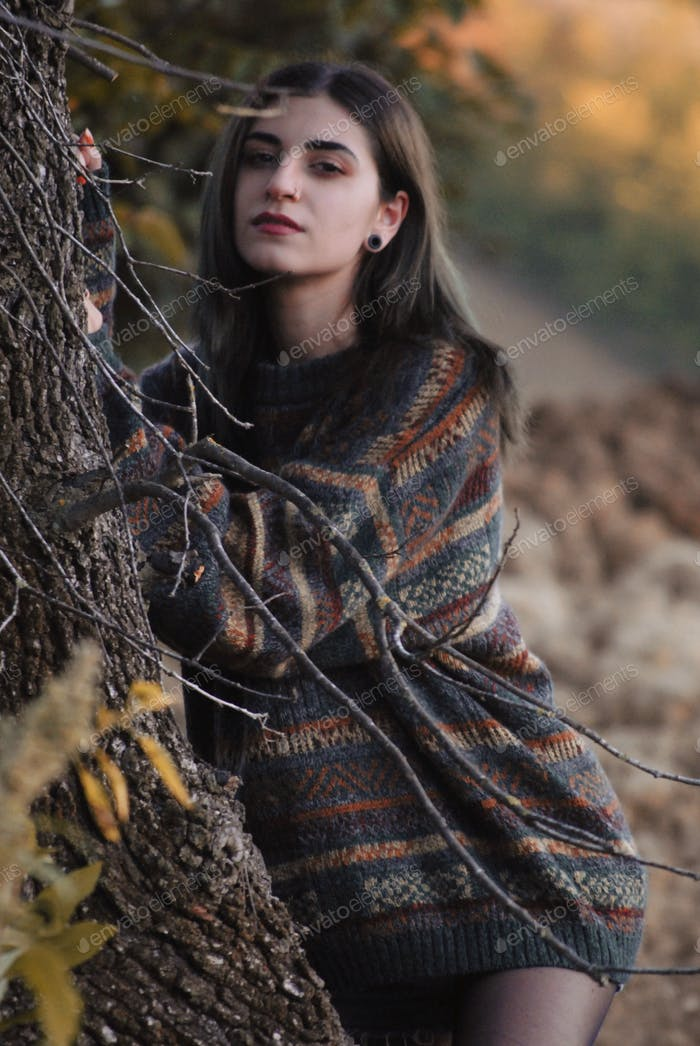 Cute girl wearing a wool sweater in the wilderness.