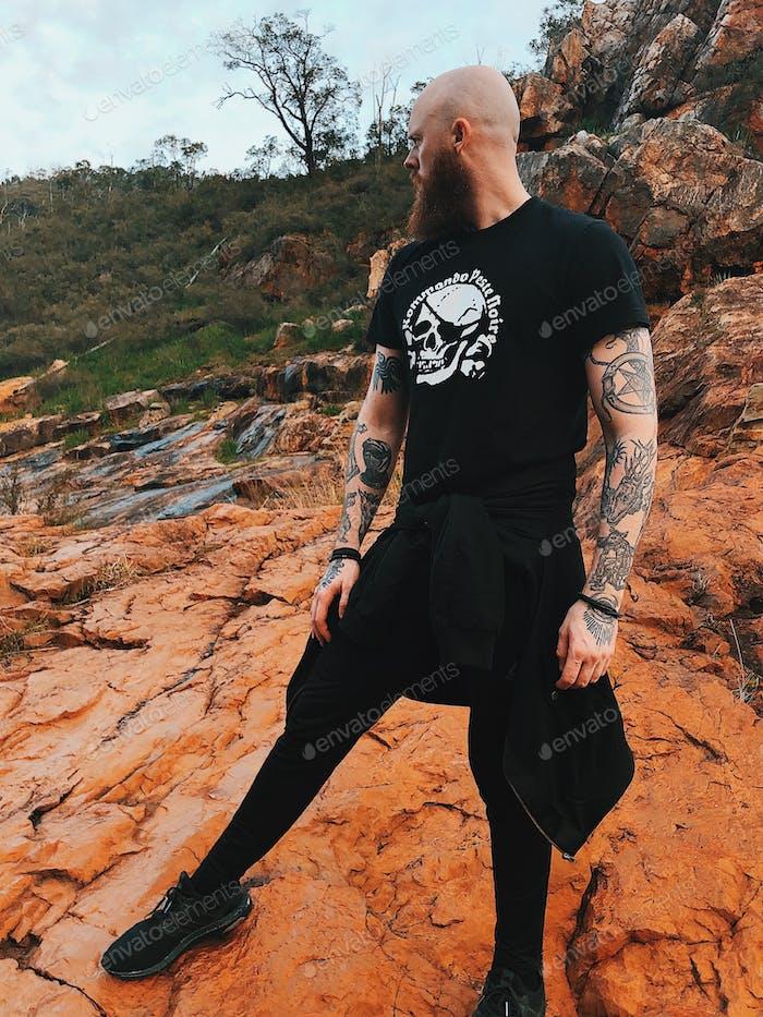 Tattooed bold man