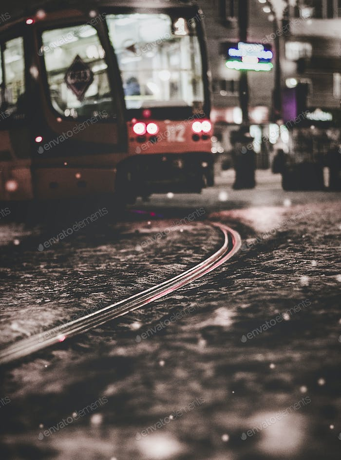 Moody tram in the night city.