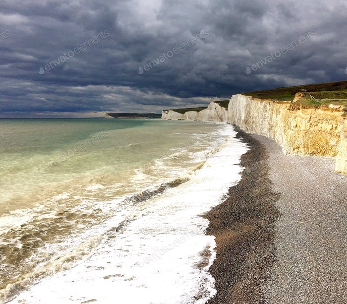Dark clouds above the ocean and cliffs of southern England; stormy weather ahead!