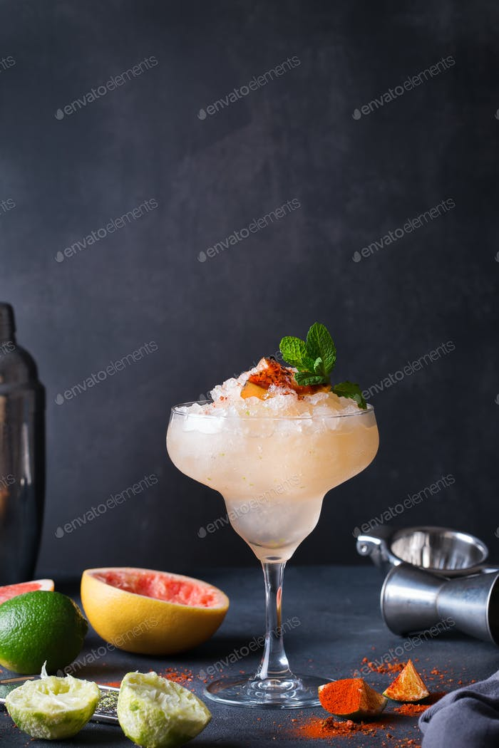 Frozen Mezcal or mescal Paloma cocktail with grilled grapefruit