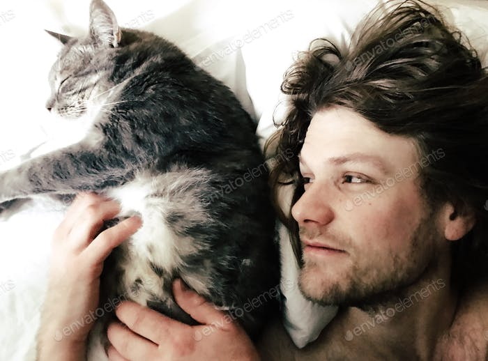 Man and cat in the morning