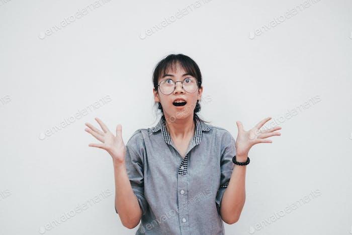 Portrait of surprised happy asian girl.