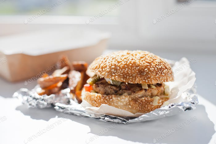 Burger and fries, takeaway food, junk fast food, tasty and yummy, food delivery