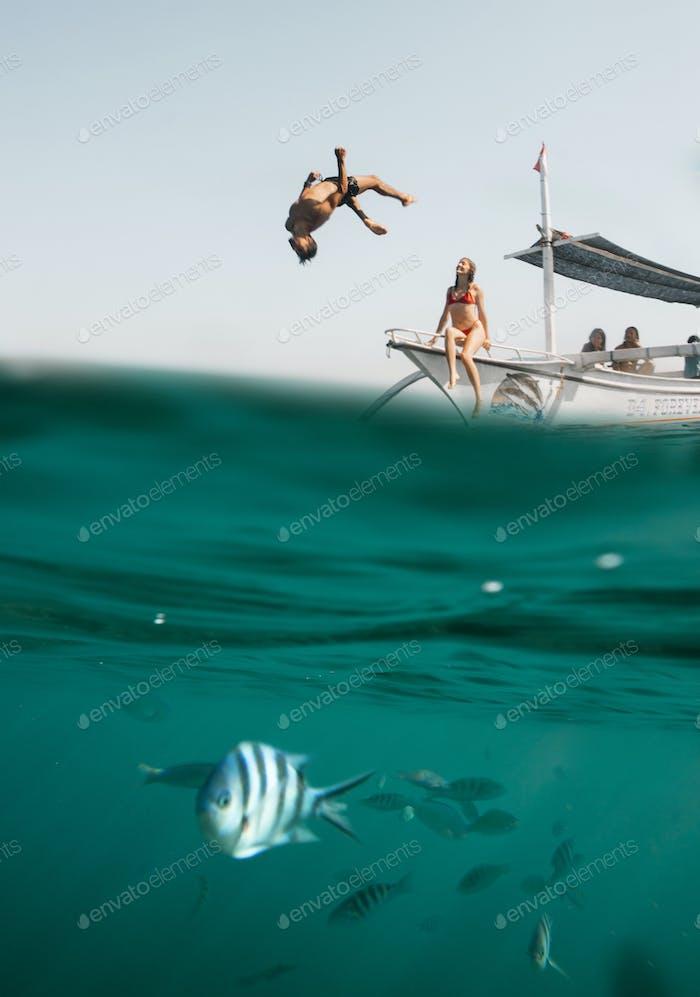 Couple enjoying tropical boating adventure