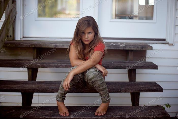 Fierce young girl in camo pants