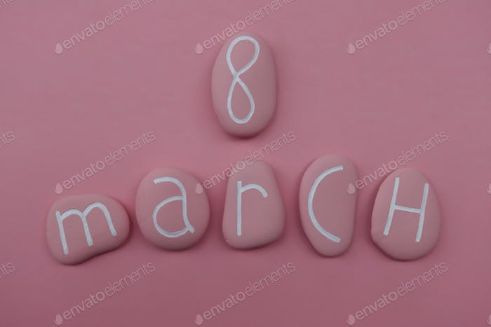 8 March, International Women's Day, calendar date with pink colored stones over pink background