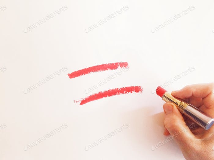 Woman female hand drawing an equal sign with a red lipstick what means a gender equality or sexual