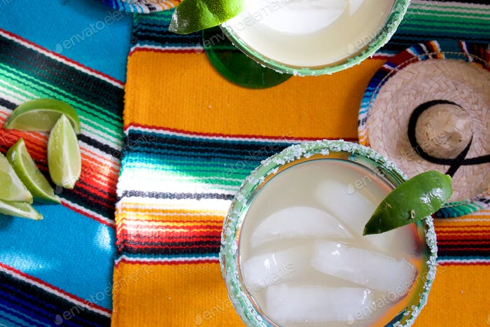 Margaritas on bright and colorful tablecloth for cinco de Mayo