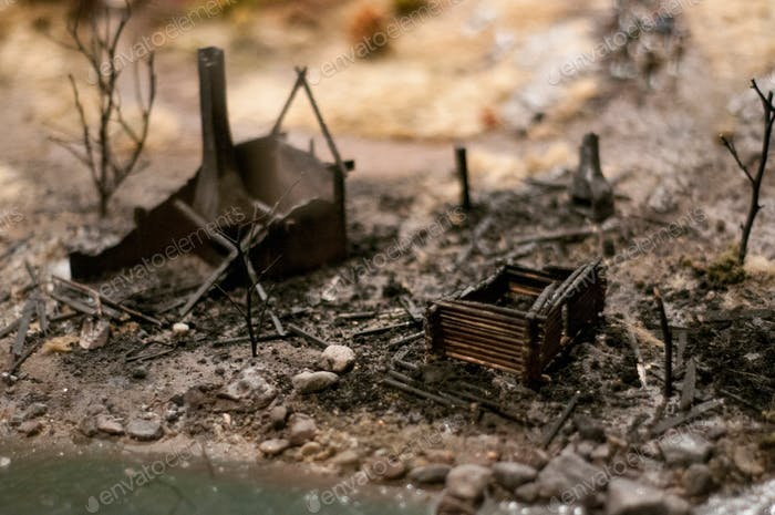 Miniature of burned and abandoned village. Consequence of war. Battlefield. Middle Ages museum.