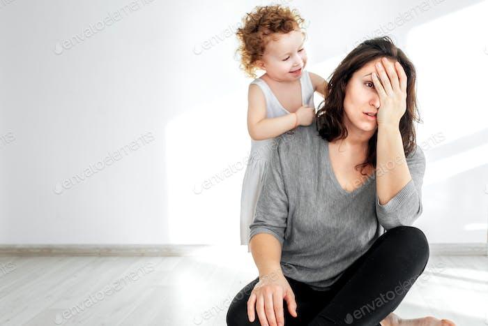tired mom, annoying child