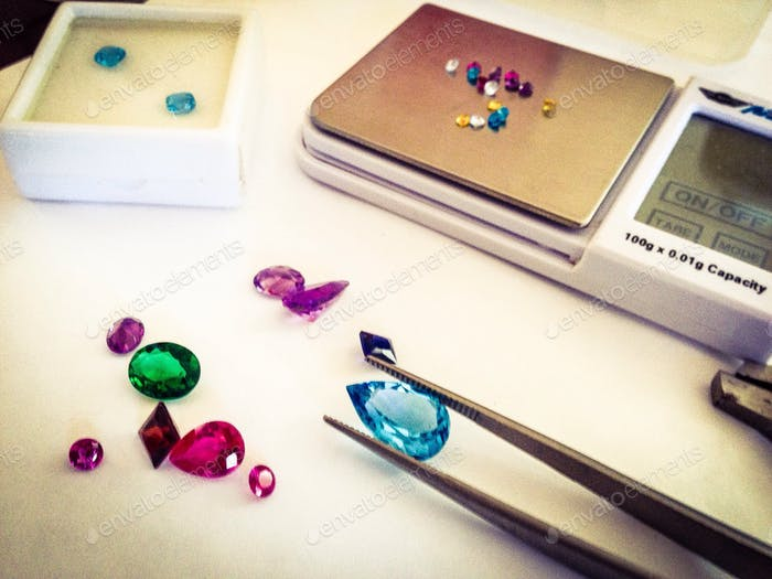 All natural, very valuable gemstones being weighed before setting.