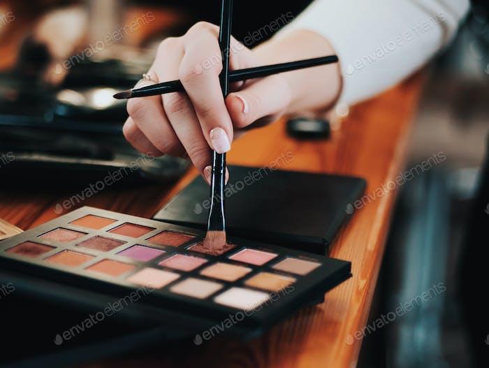 Eye shadows. Makeup artist working