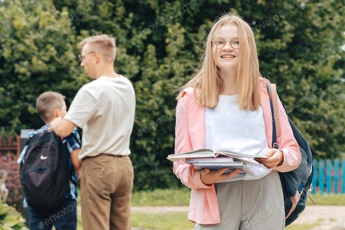 Portrait of teeenager schholgirl student with schoolbag backpack wear pink shirt eyeglasses. Generat