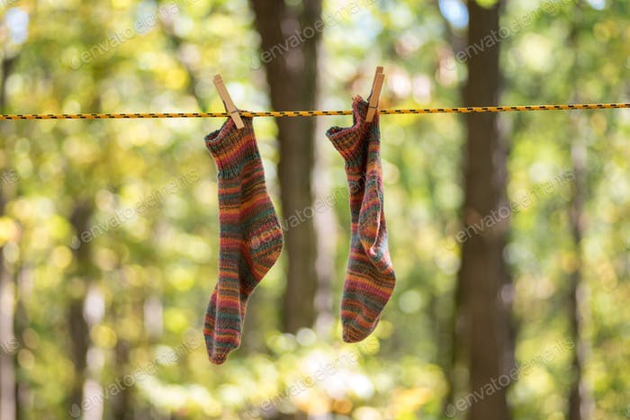Camping life - colorful hand knit socks hanging to dry on the clothesline  💫