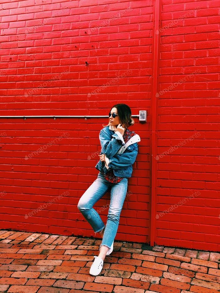 Girl wearing blue denim Sherpa jacket and jeans