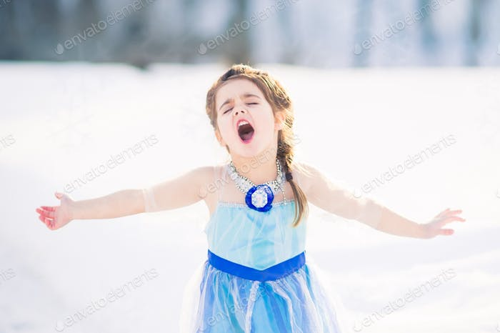 Little girl singing outside in the winter singing a song!