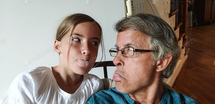 Granpa and granddaughter communicating their deepest feelings for each other through tongue language