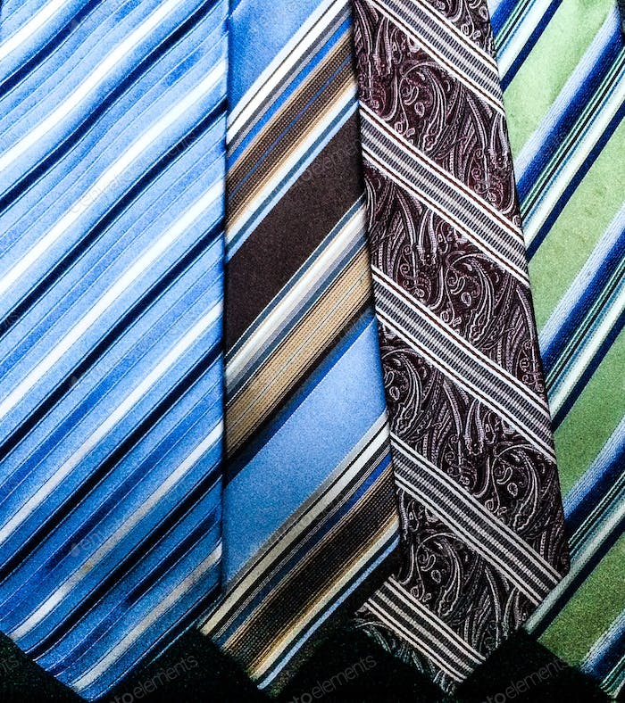 Striped ties close up view menswear closet.