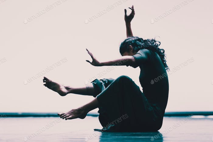 Young Woman Dancer On The Floor