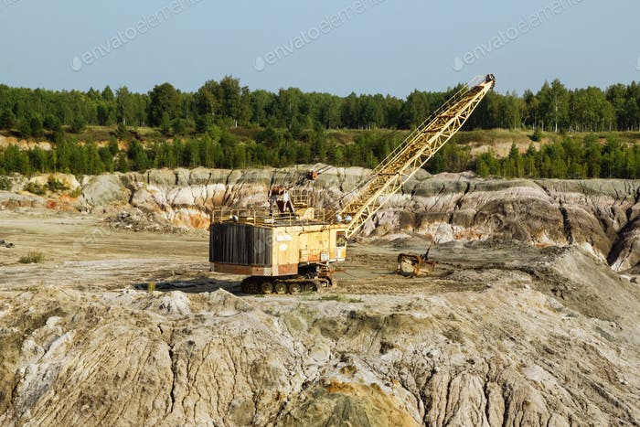 Old quarry for the extraction of clay with excavator.