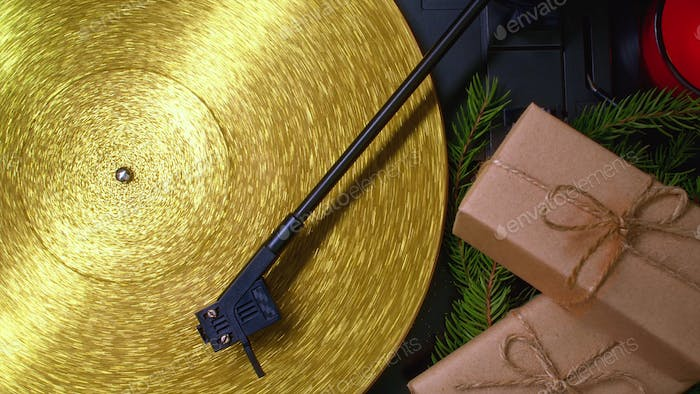 Fortuna gold, movie of retro-styled record player spinning golden vinyl. Cinemagraph. Christmas conc
