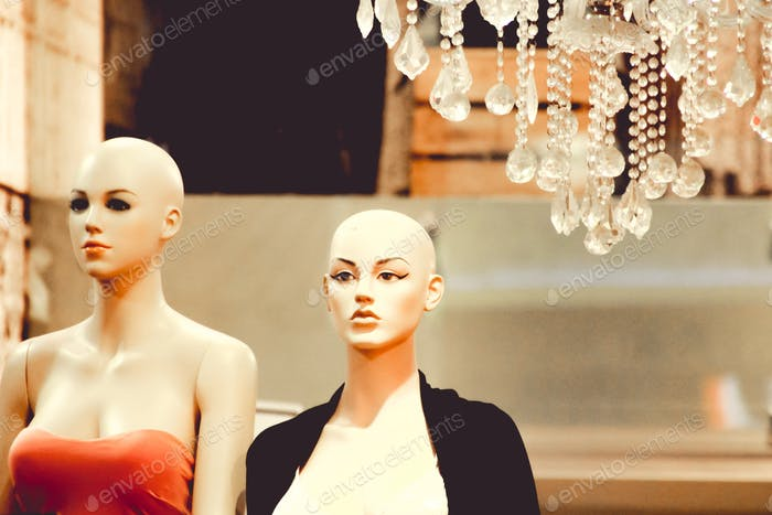 mannequins and a chandelier