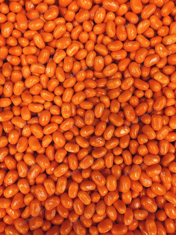 Orange jellybeans candy in bulk