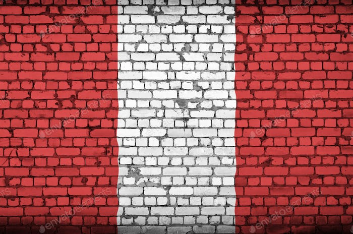 Peru flag is painted onto an old brick wall