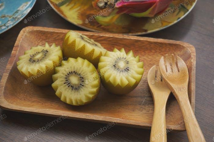 Kiwi on wooden plate