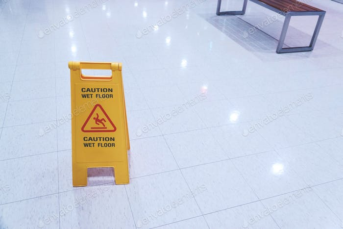 Yellow Sign showing warning of caution wet floor