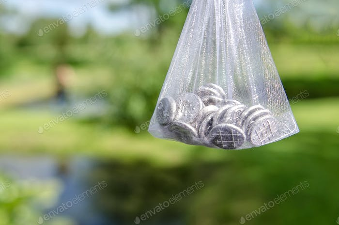 Bag with wedding day inbound souvenir coins.