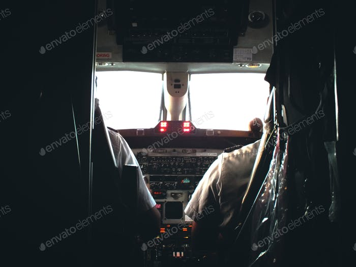 Cockpit of the plane Pilot and copilot flying the plane