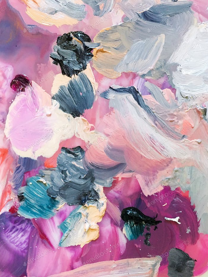 Vibrant smears and swirls of paint on an artist's palette.