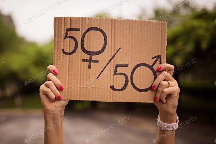 Woman holding gender equality sign on protest