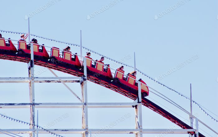 People riding the historic Giant Dipper roller coaster at Belmont Park in Mission Beach