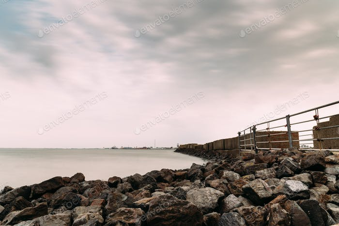 Long exposure view of the sea and the breakwater in Cuxhaven, Germany.