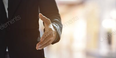 Businessman offering his hand for handshake