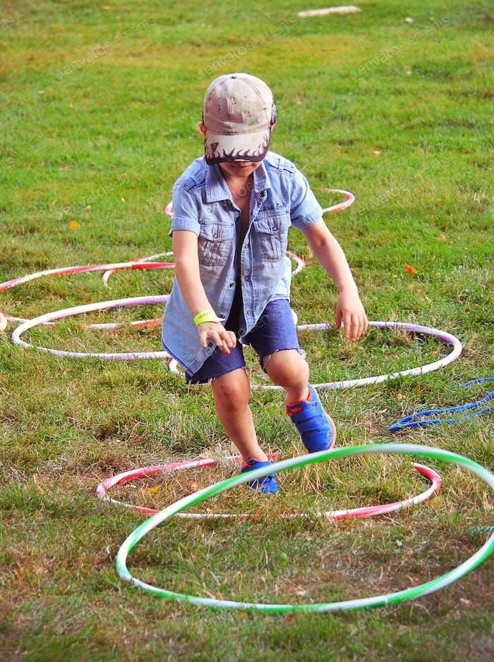 Boy playing with hula hoops