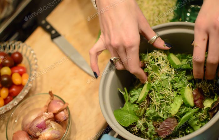 Elevated view of making a healthy salad at home in kitchen