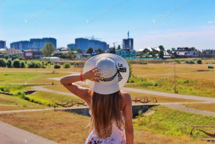 A girl in a summer hat