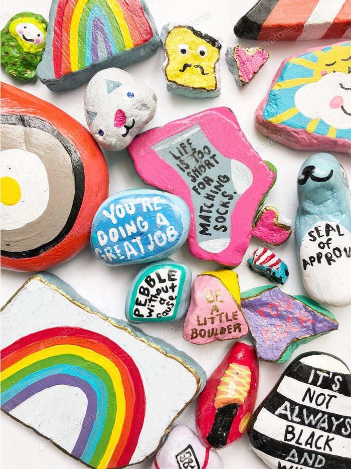 Bright and colorful painted rocks to spread kindness and happiness.