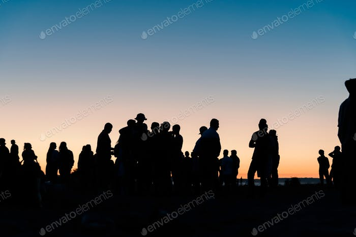 Young people beach party silhouettes