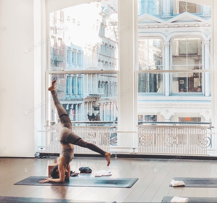 Woman doing forearm handstand in the yoga studio